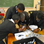 Group working on robot