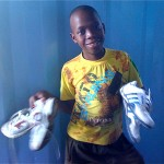 Boy with 2 pairs of shoes